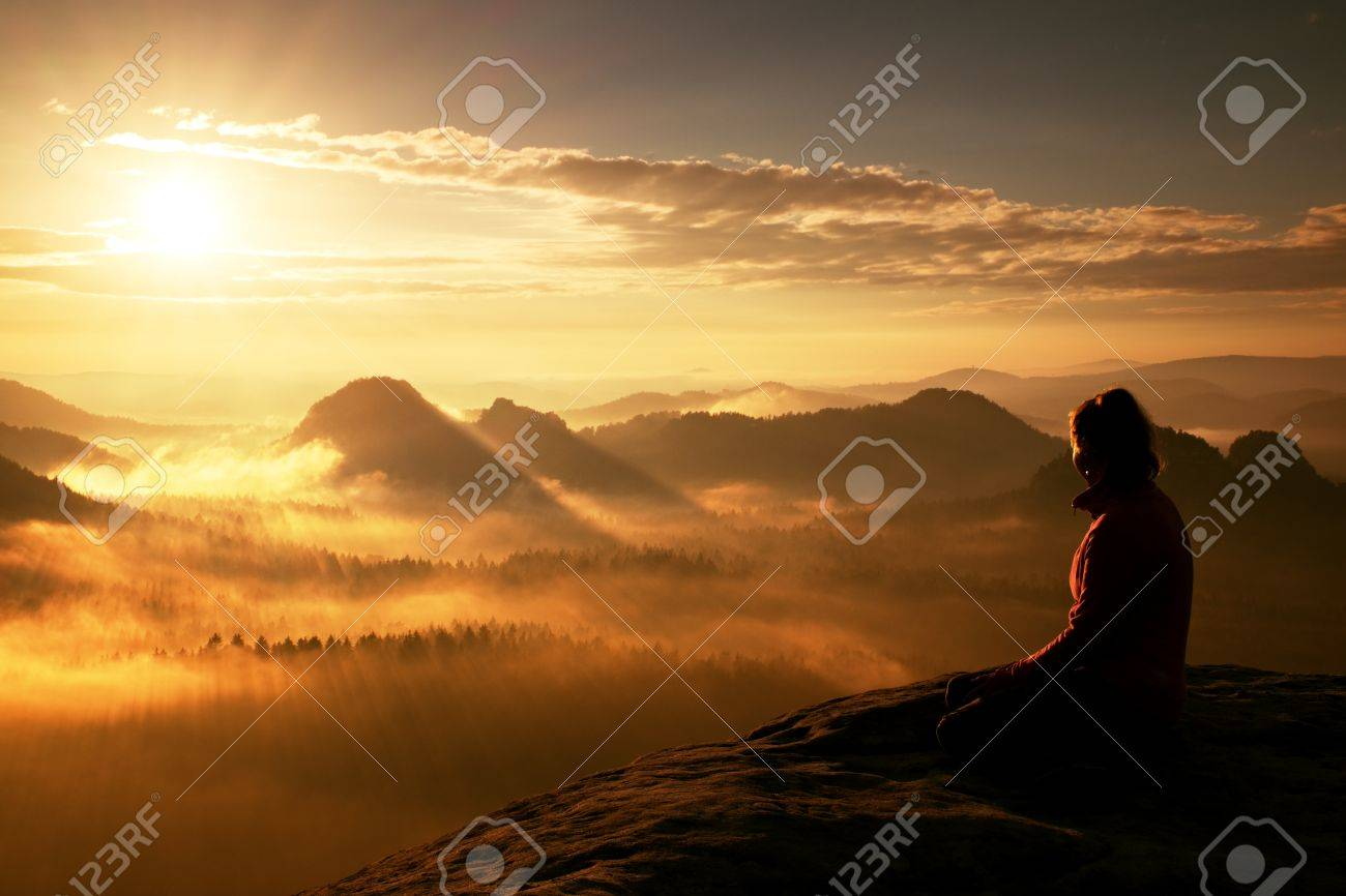 Beautiful young woman tourist enjoy daybreak on the sharp corner of sandstone rock and watch over valley to Sun. - 48102609