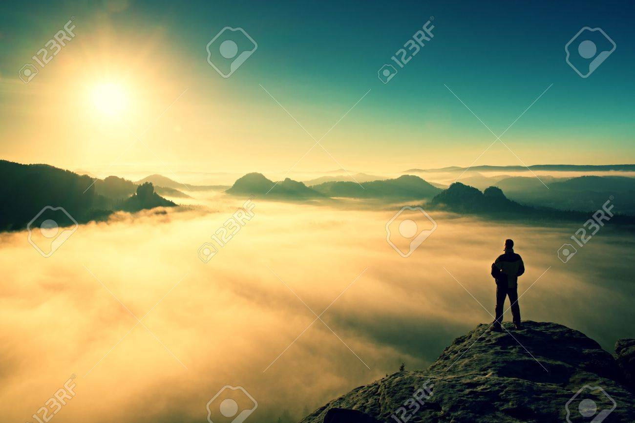 Man stands on the peak of sandstone rock in national park Saxony Switzerland and watching to Sun. Beautiful moment the miracle of nature - 49062586