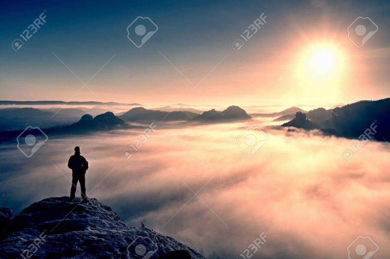 Man stands on the peak of sandstone rock in national park Saxony Switzerland and watching to Sun. Beautiful moment the miracle of nature - 49062602