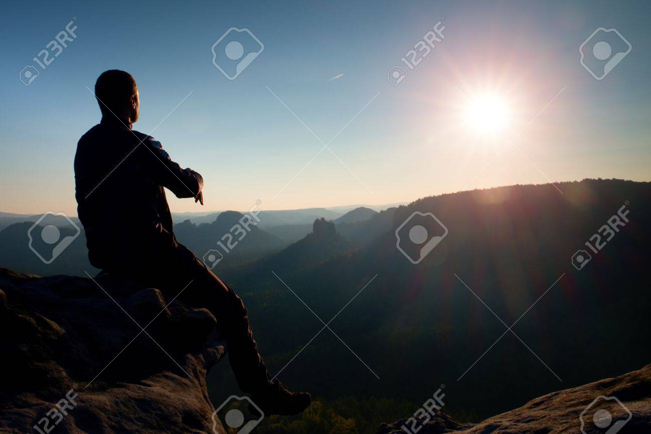 Man tourist sit on peak of mountain. Travel mountain scene. - 50042166