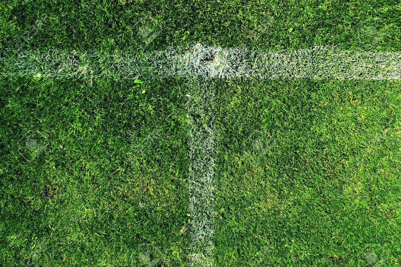 Cross Of White Lines Painted On Poor Natural Grass Football Stock