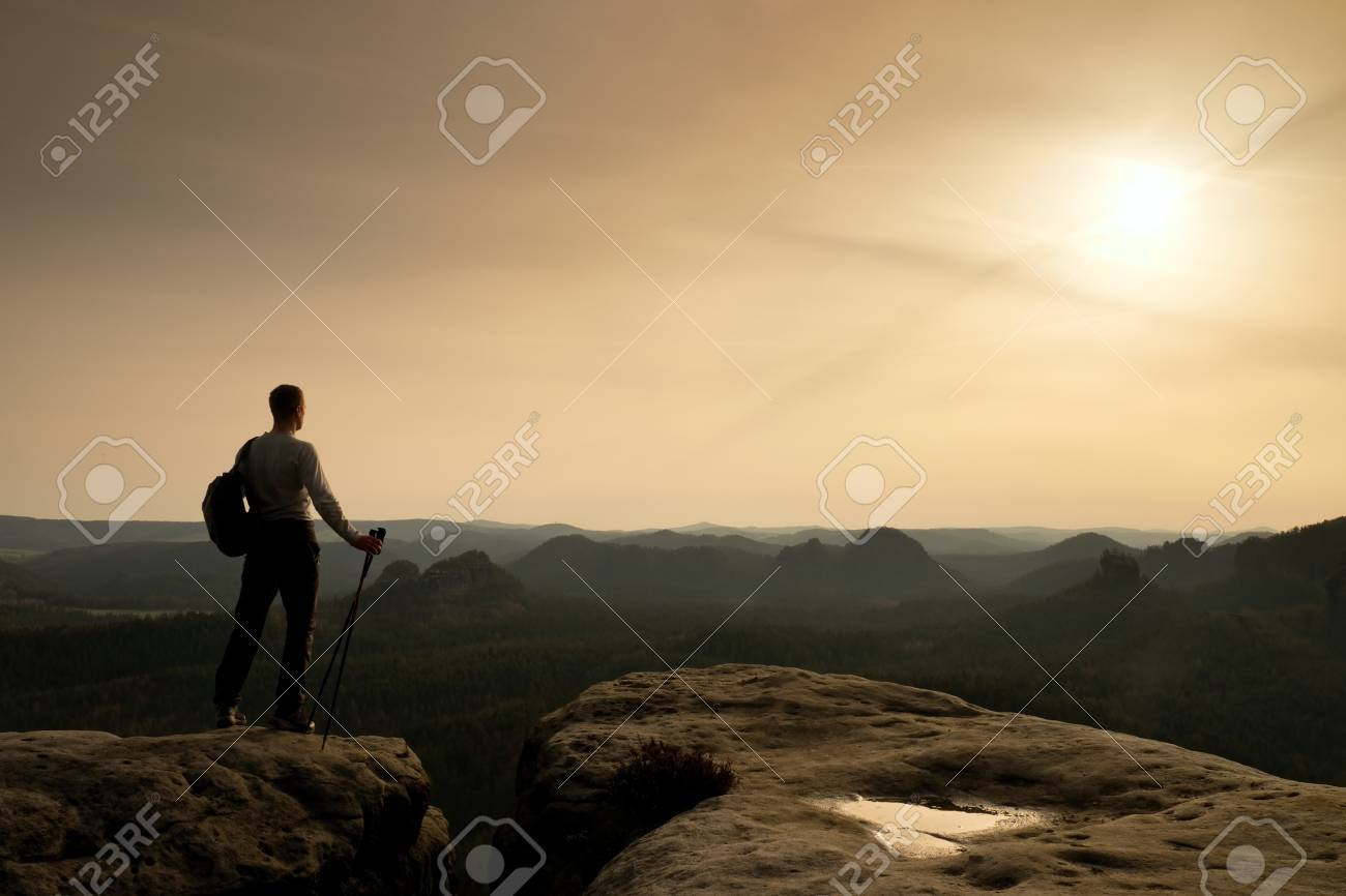 tourist guide on cliff edge with pole in hand hiker with sporty rh 123rf com rocky mountain tourism guide Rocky Mountain Jeep Tours