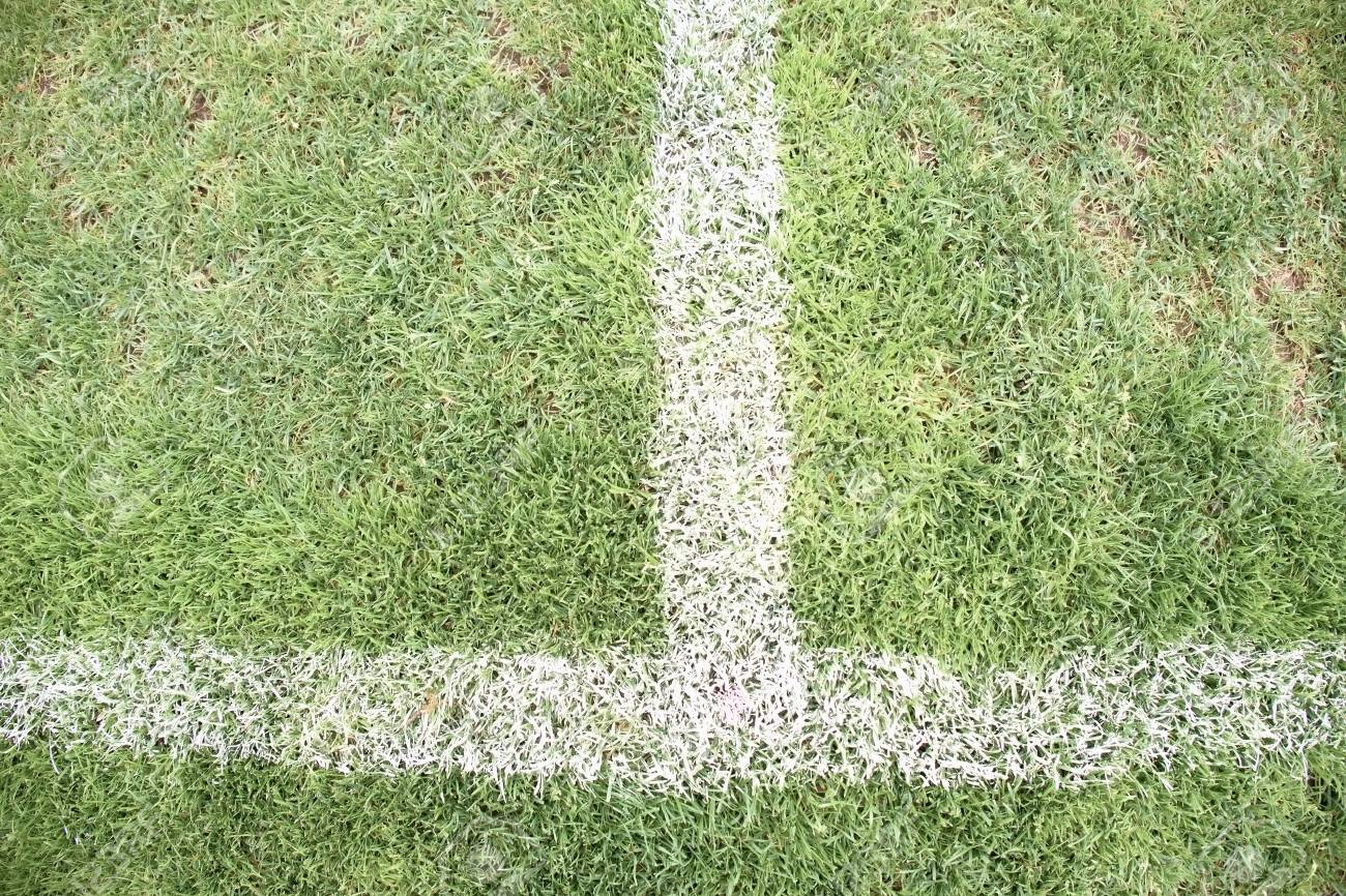 Cross Of Painted White Lines On Poor Natural Football Grass Stock