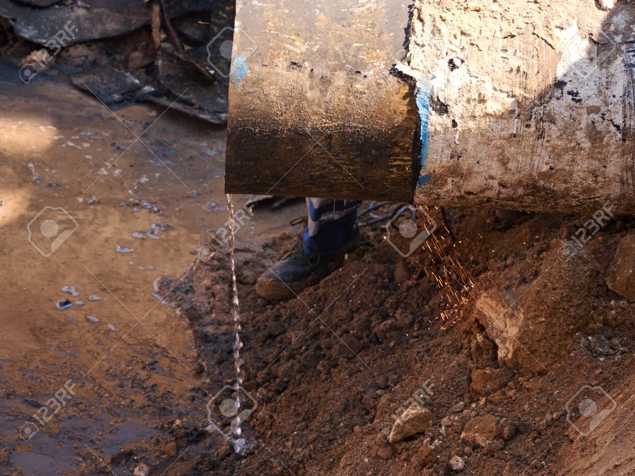 Rusty Old Iron Pipe With Clear Water Flowing From It. Waste water drain pipe in & Rusty Old Iron Pipe With Clear Water Flowing From It. Waste Water ...
