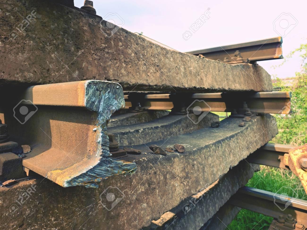 Stolen rail  Detail of autogen torch cut rail on concrete concrete
