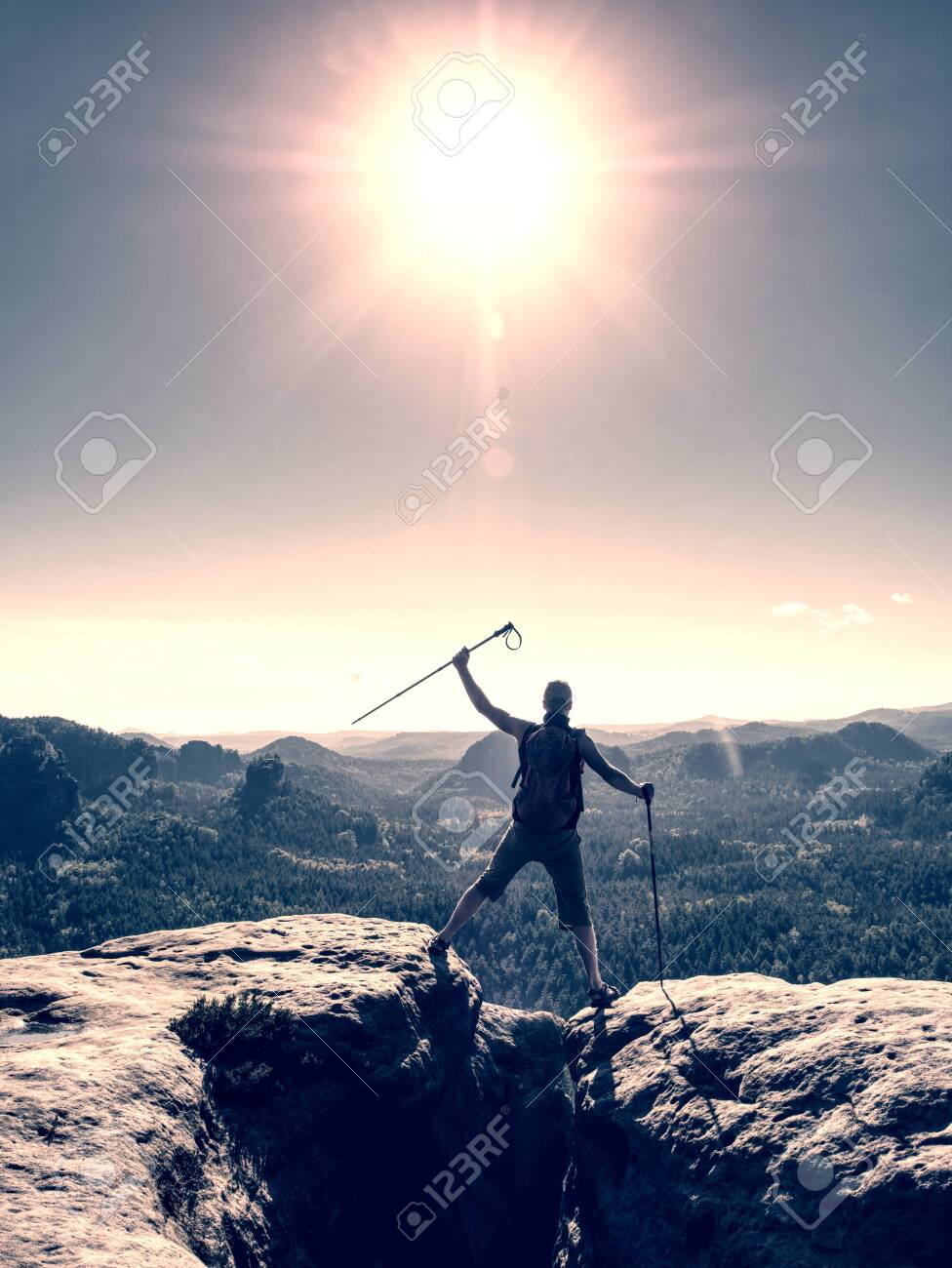 Successful man screaming with happiness on a mountain peak. Achieving of personal target - 140447954