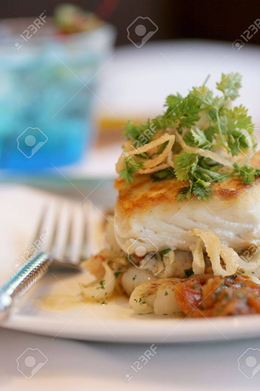 Fresh sauteed sea bass on bed of roasted vegetables Stock Photo - 3215006