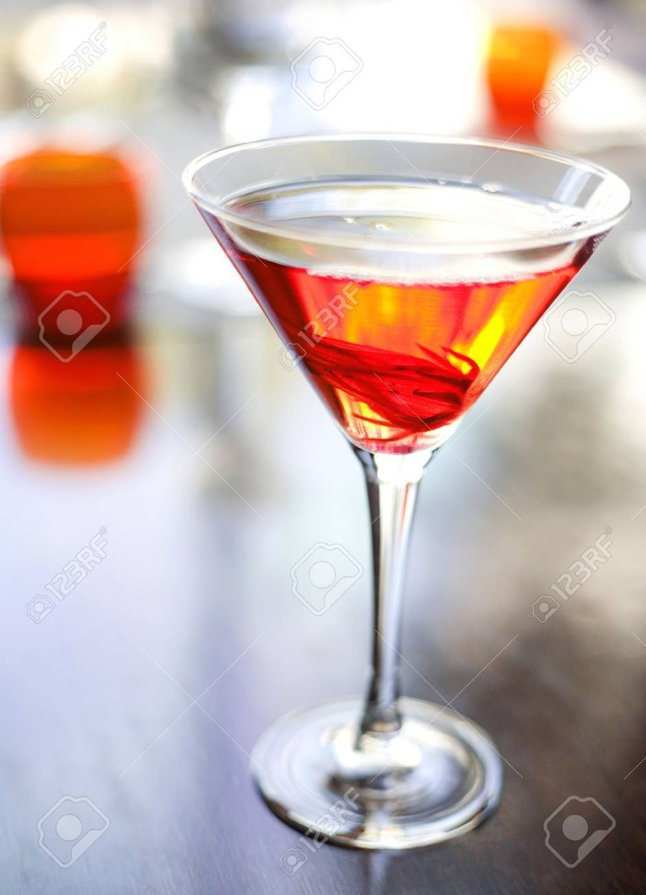 The martini reincarnated with hibiscus syrup and candied blossom Stock Photo - 4737123