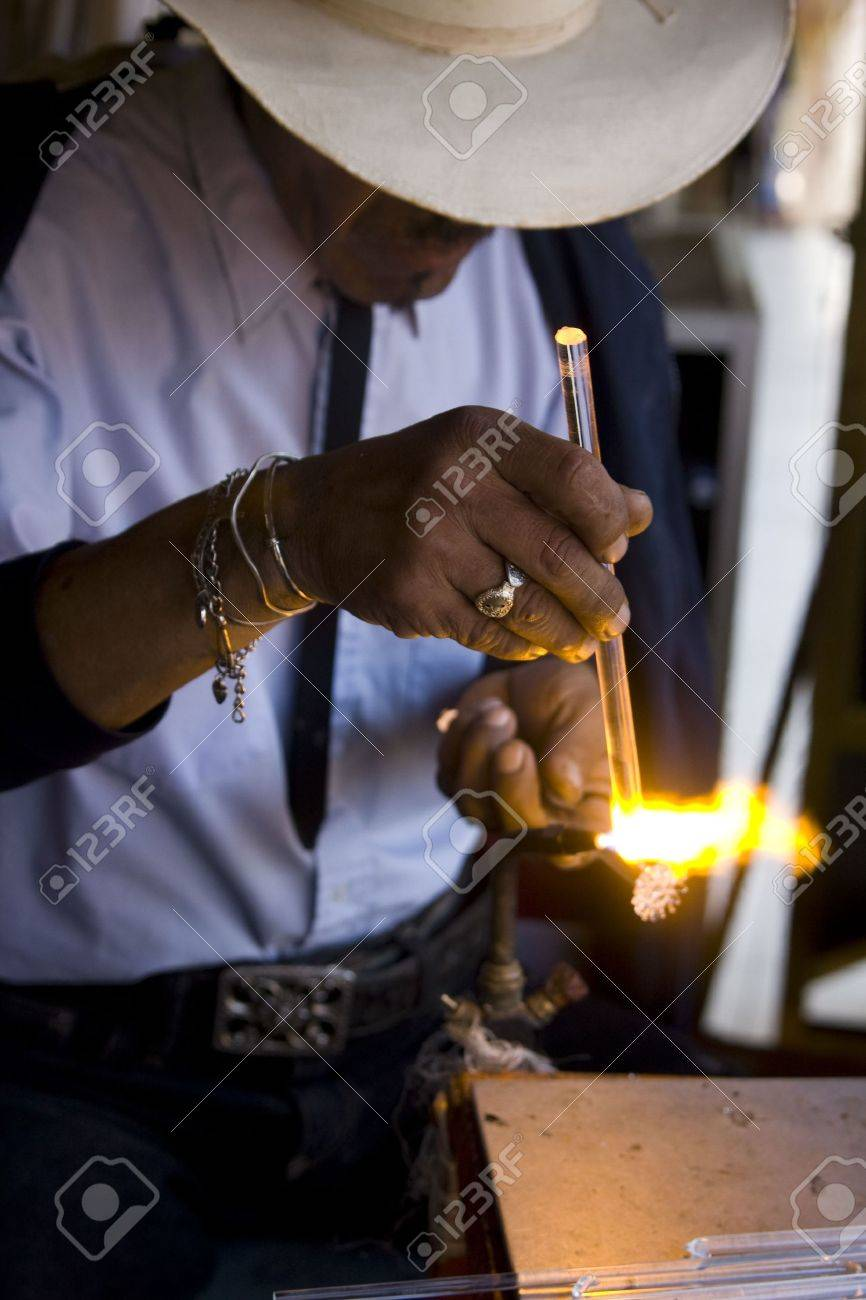 Glass blower working in an open air market in Baja California, Mexico. Stock Photo - 6352762