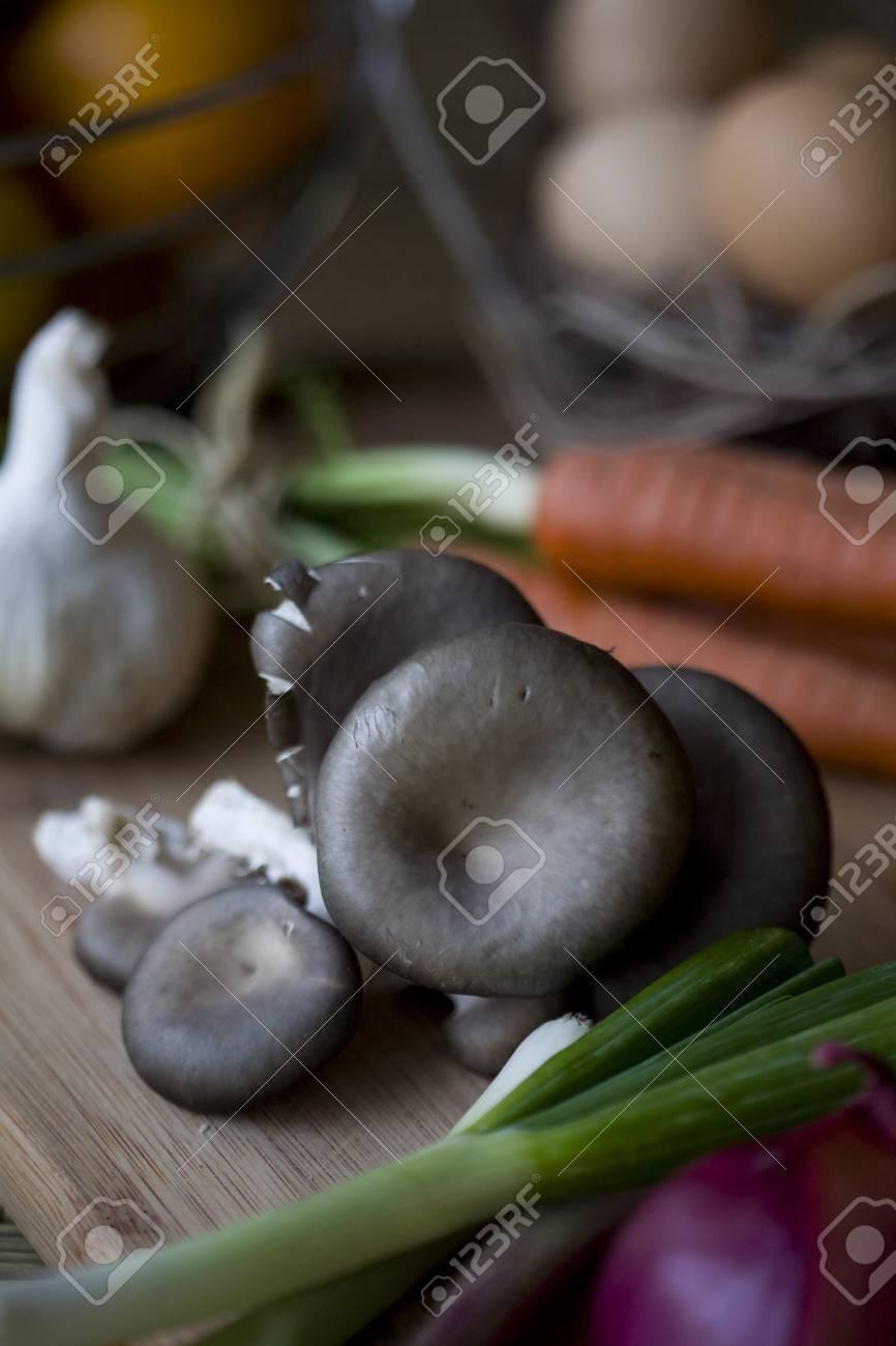 Fresh organic oyster mushrooms on a chopping block Stock Photo - 8503920