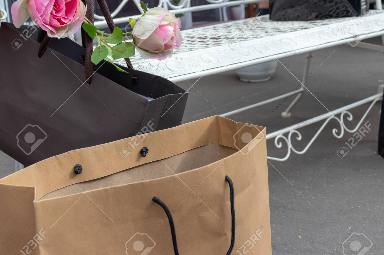 Awe Inspiring Black And Beige Paper Shopping Bags On The Ground Near The White Andrewgaddart Wooden Chair Designs For Living Room Andrewgaddartcom
