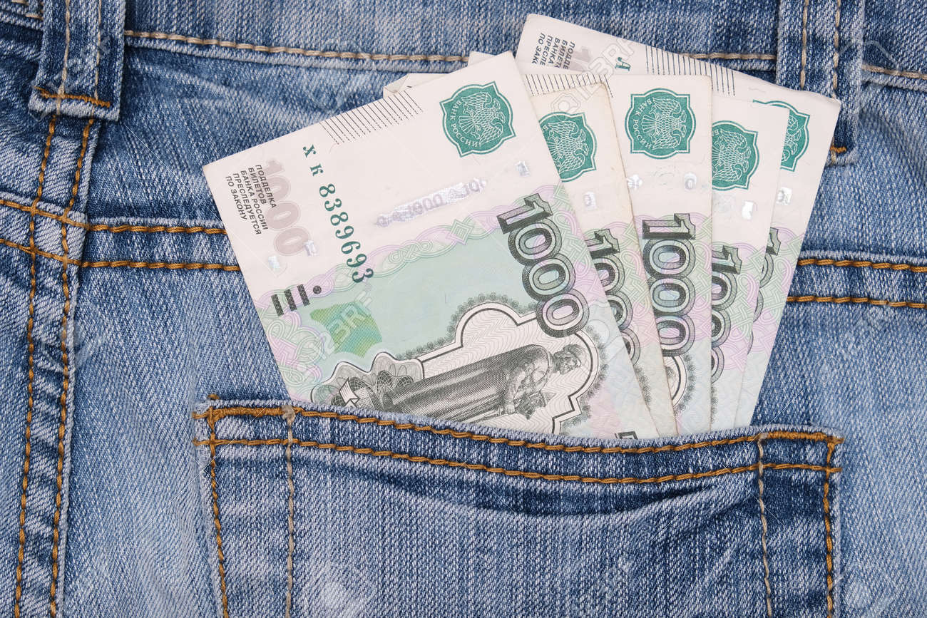 Paper 1000 banknotes of russian rubles in a jeans pocket - 165950865