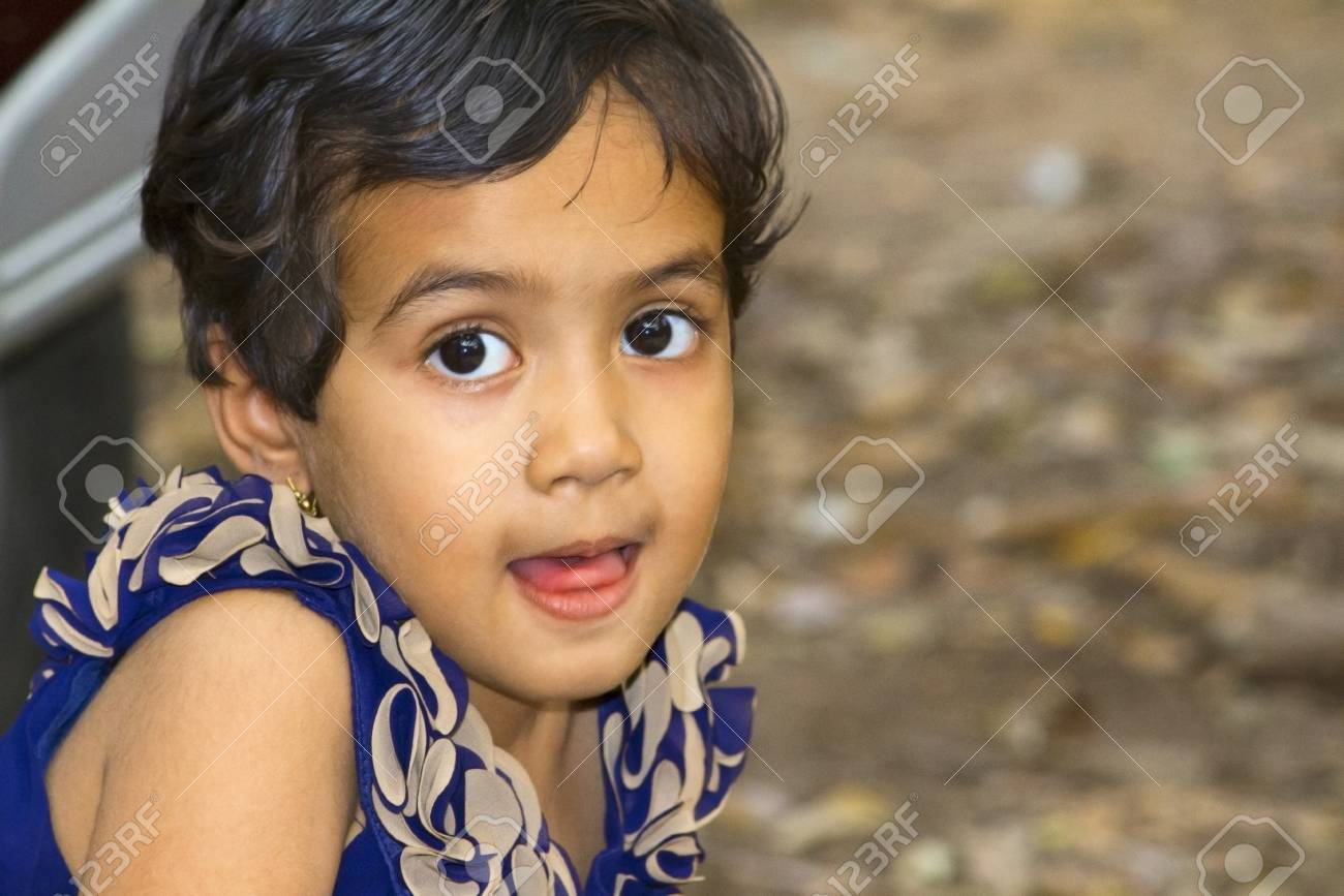 Close Up Of Little Indian Girl With Her Mouth Open, Empress Garden ...