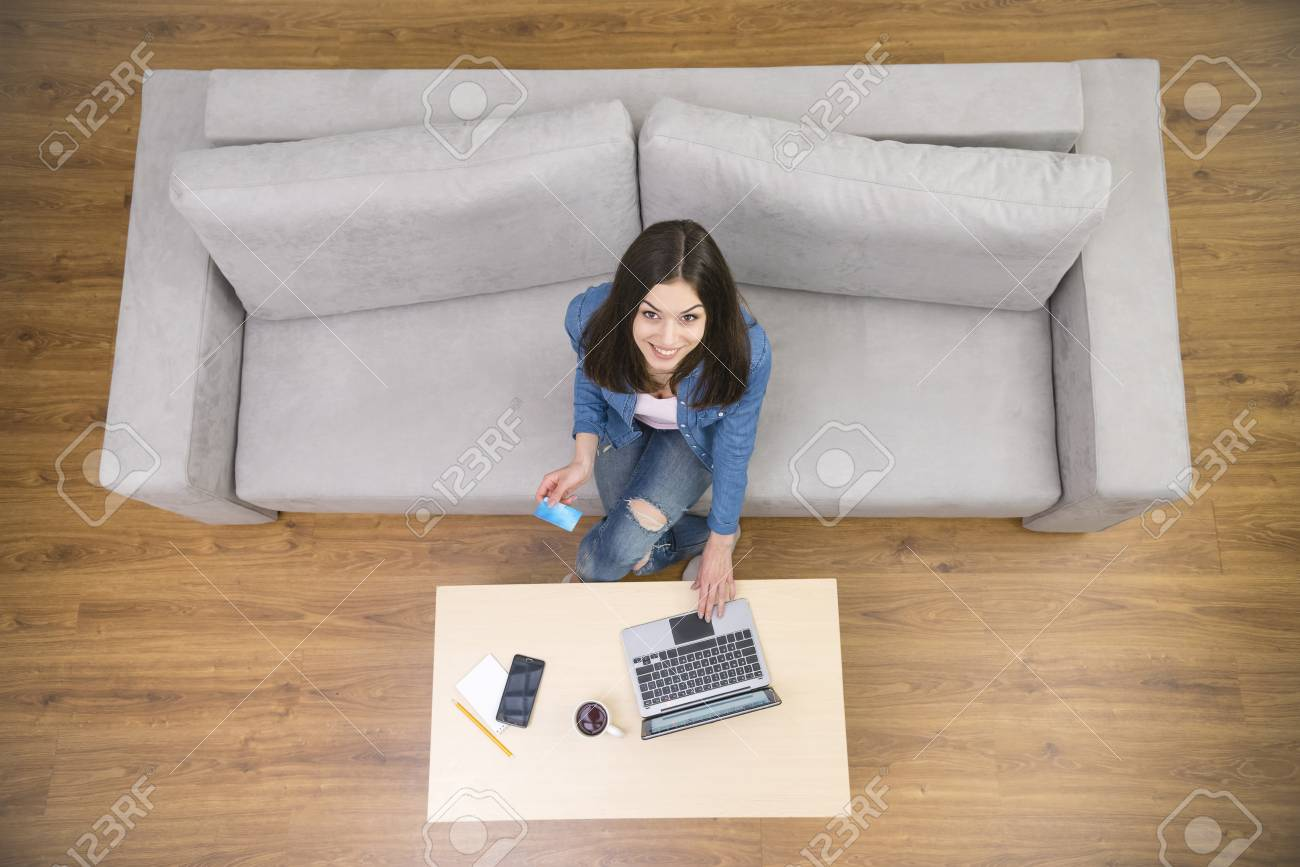 The Young Woman Work With A Laptop On The Sofa View From Above