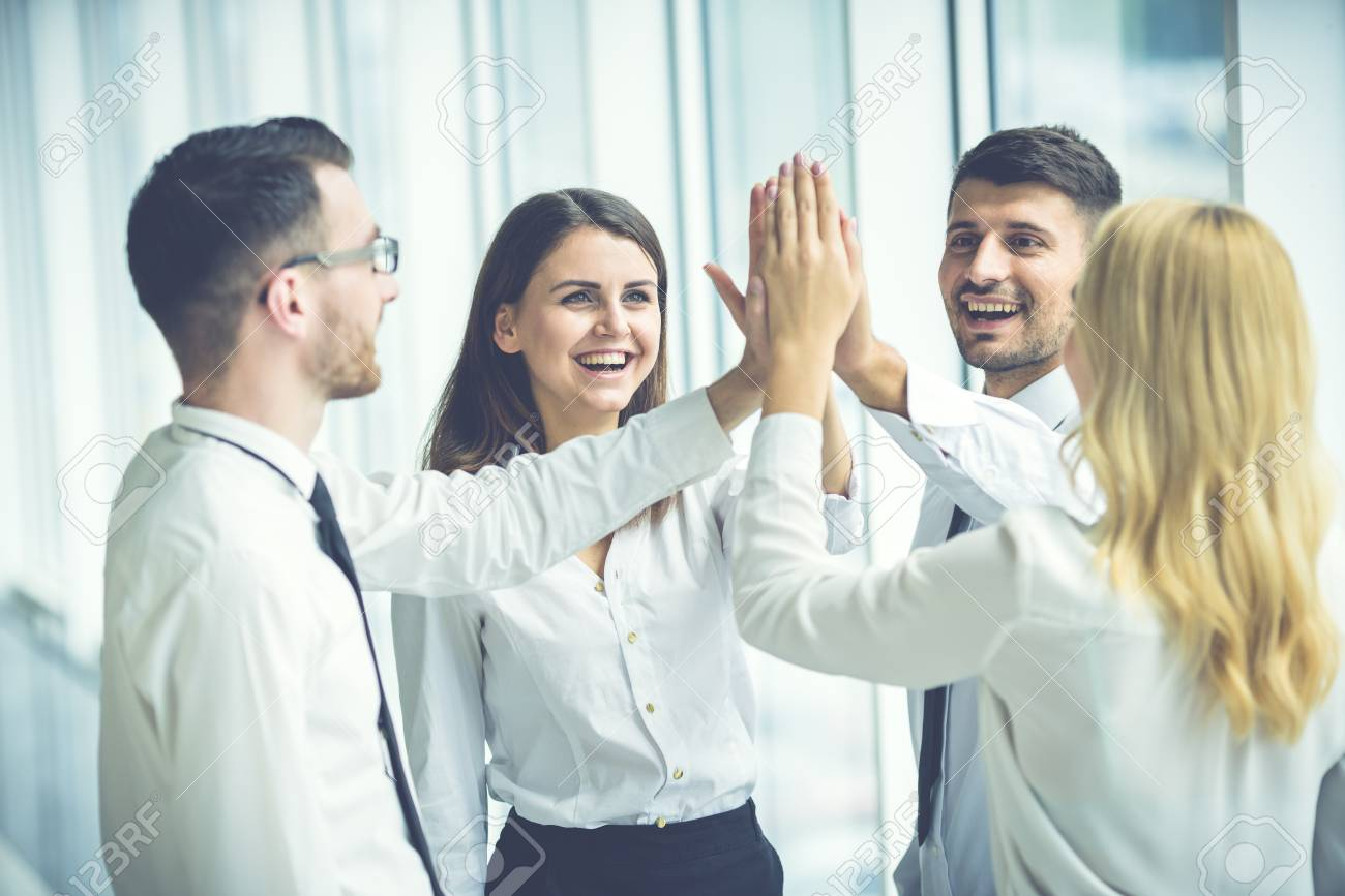 The four business people greeting with a high five stock photo stock photo the four business people greeting with a high five m4hsunfo