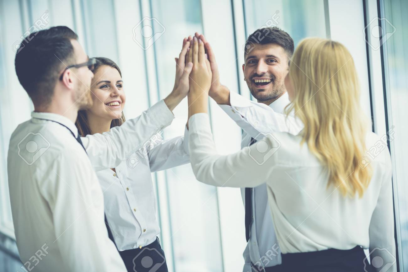 The four happy people greeting with a high five stock photo picture stock photo the four happy people greeting with a high five m4hsunfo