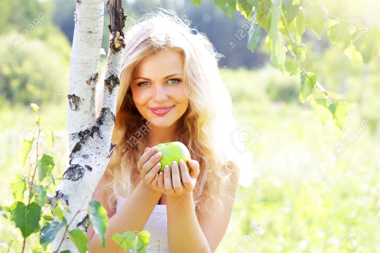 Beautiful girl holding an apple Stock Photo - 7436420