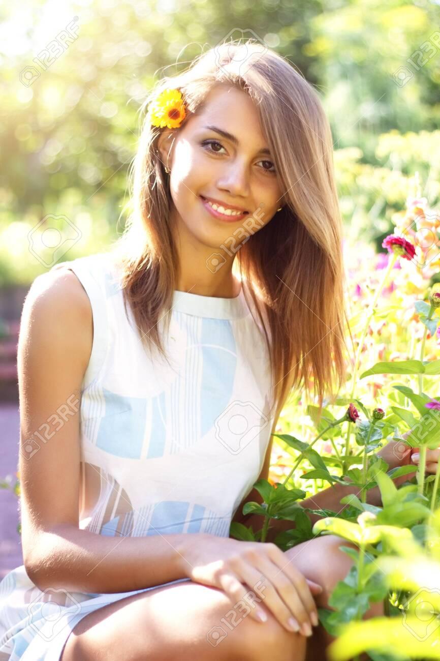 Beautiful girl in a flowered garden Stock Photo - 7511453
