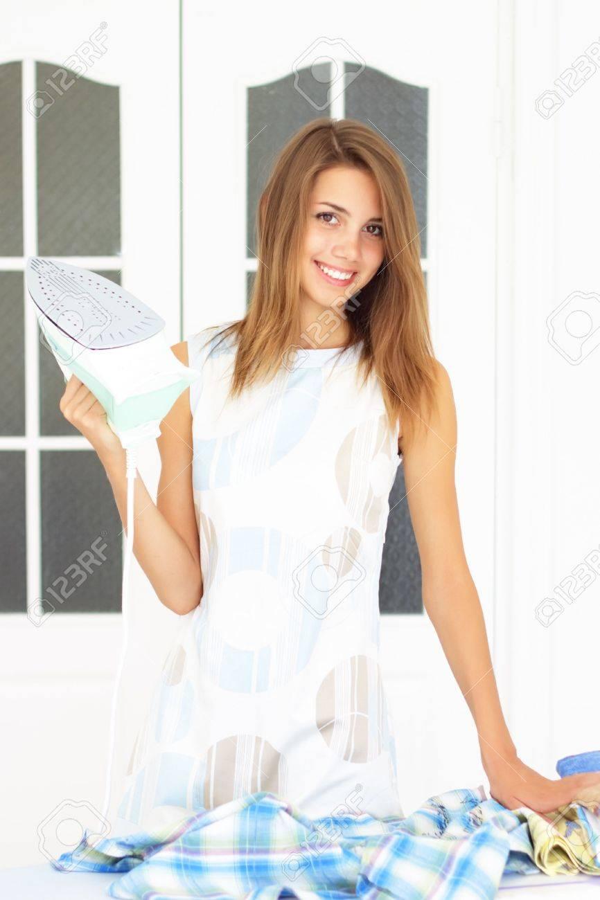 Beautiful girl next to ironing board Stock Photo - 7579026