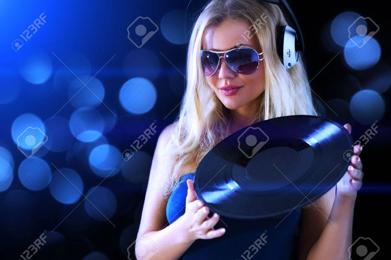 Beautiful girl listening to music Stock Photo - 7706878