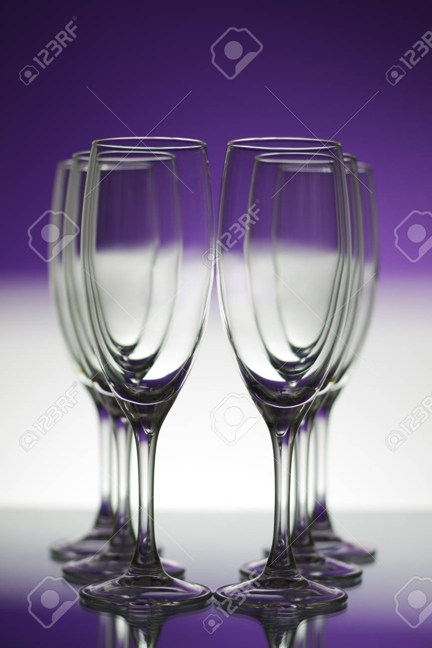 Empty champagne glasses on purple background Stock Photo - 8534658