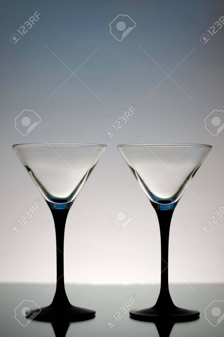 Two Martini Glasses on a gray background Stock Photo - 8534668