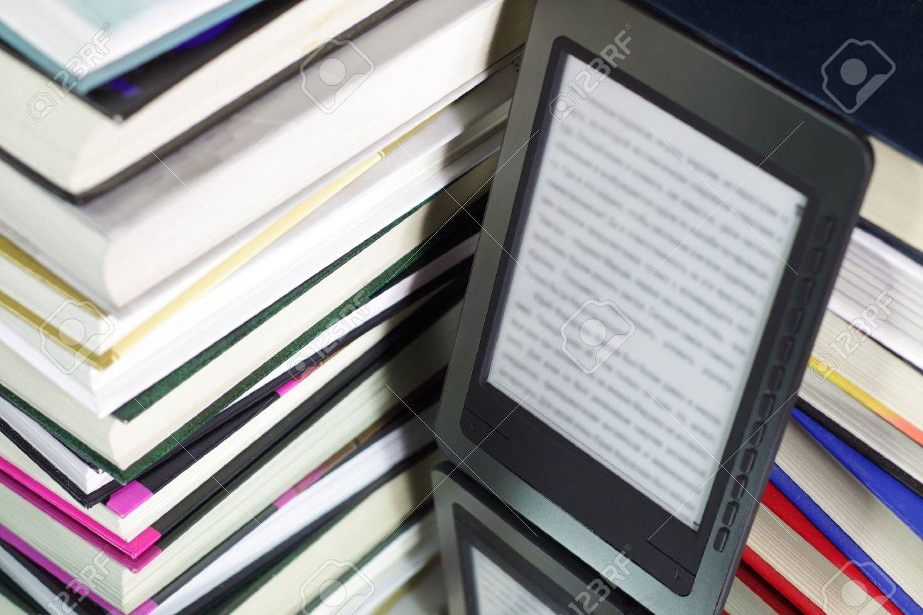 E-book reader against the background of a stack books Stock Photo - 8534737