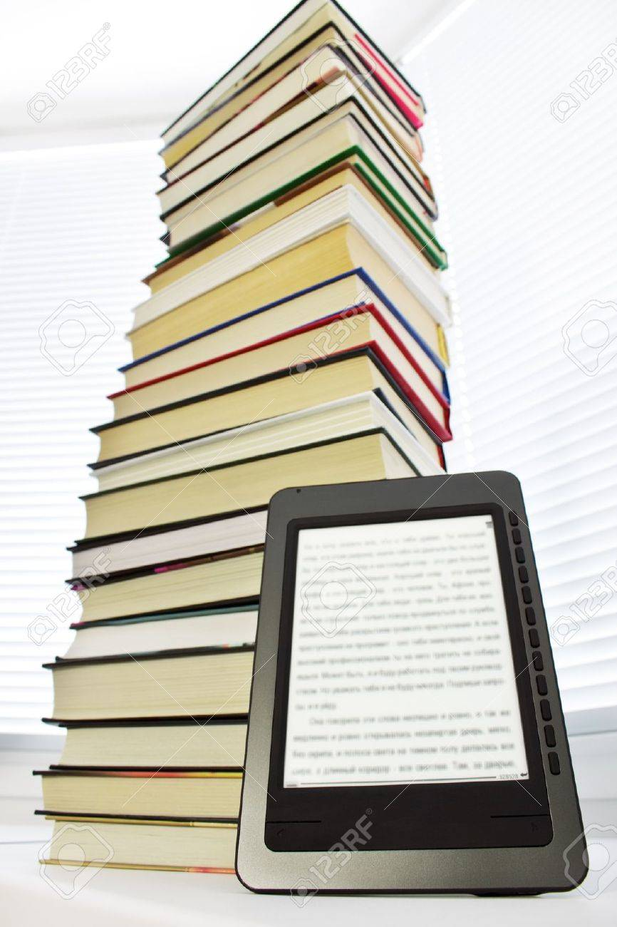 Ebook reader on a light background window Stock Photo - 8632810