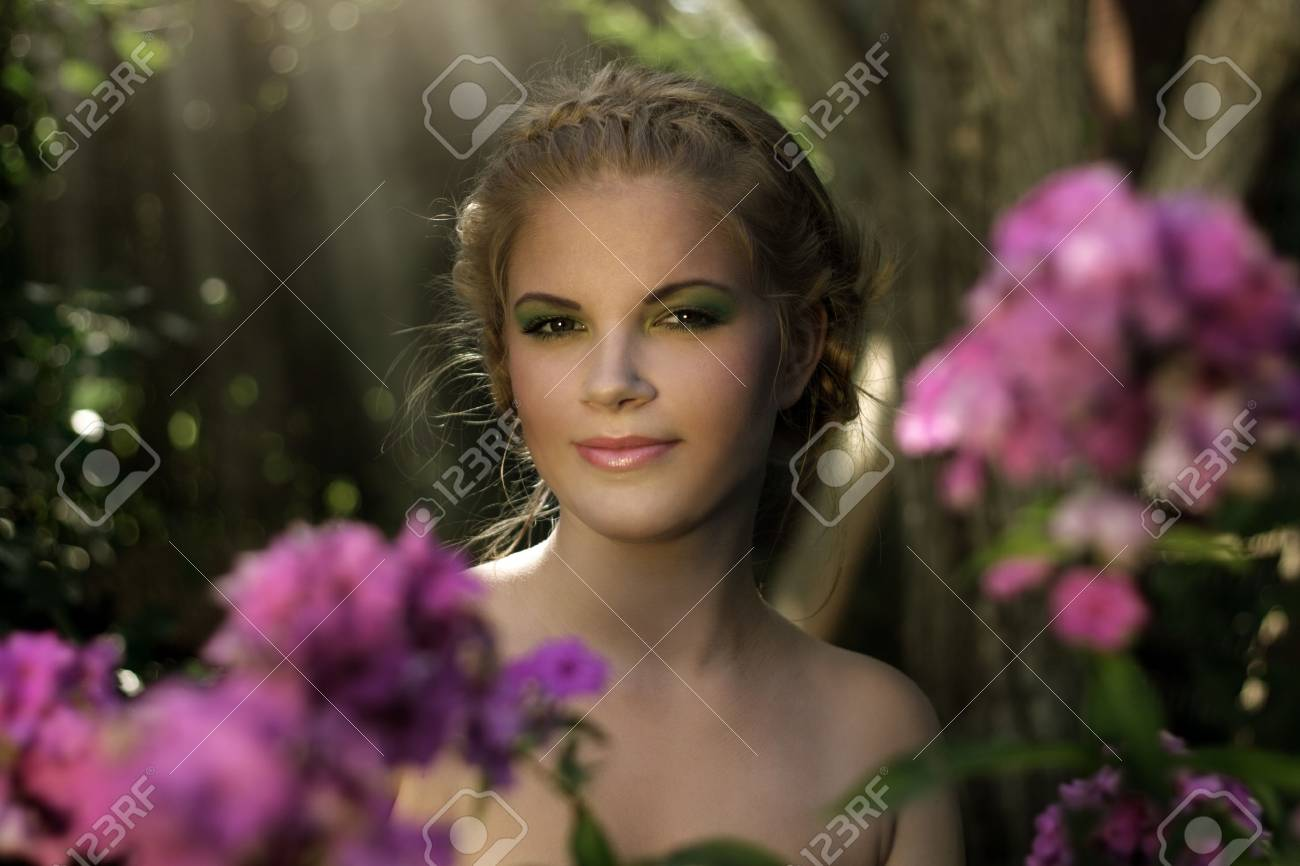 Girl In The Garden On Dark Background Stock Photo, Picture And ...