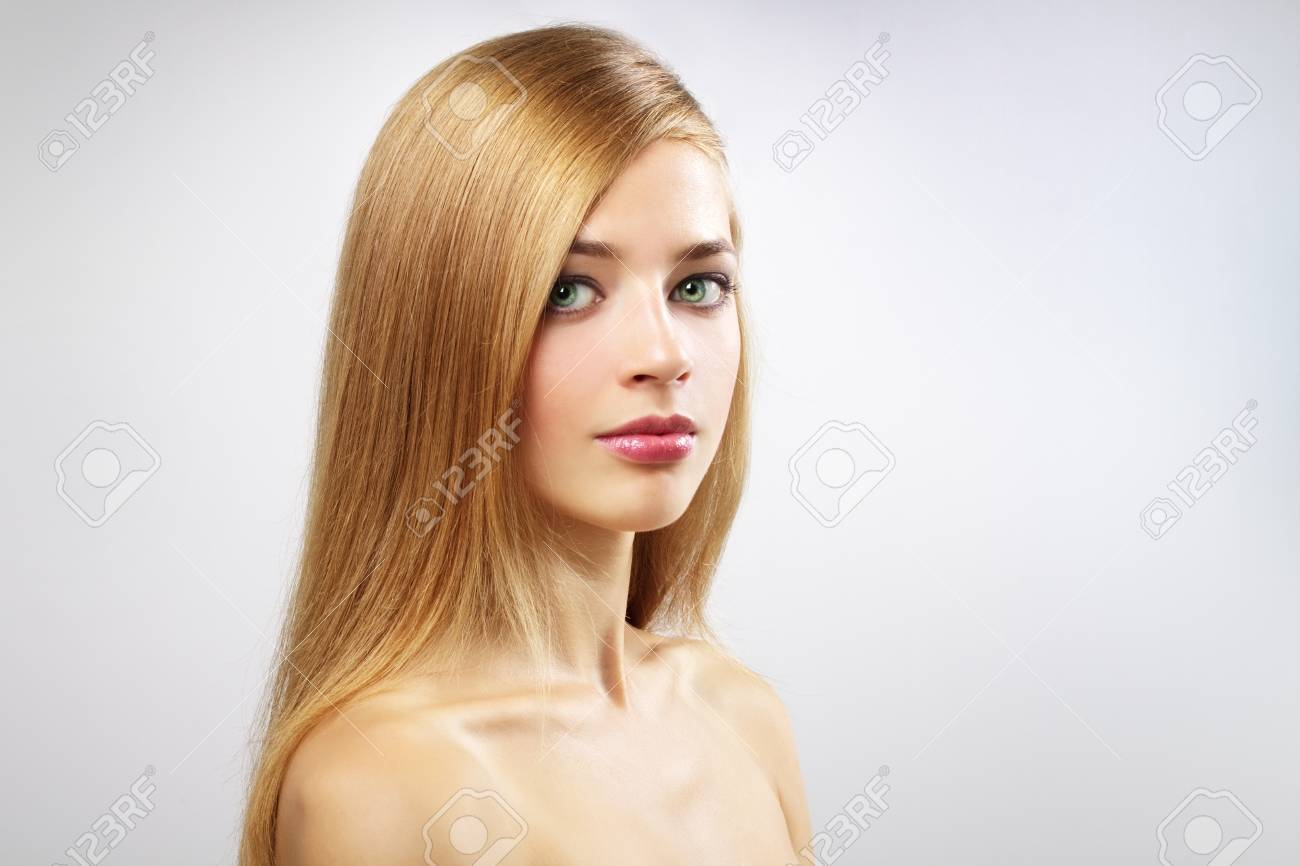 Pretty girl with long hair on a gray background Stock Photo - 10505920