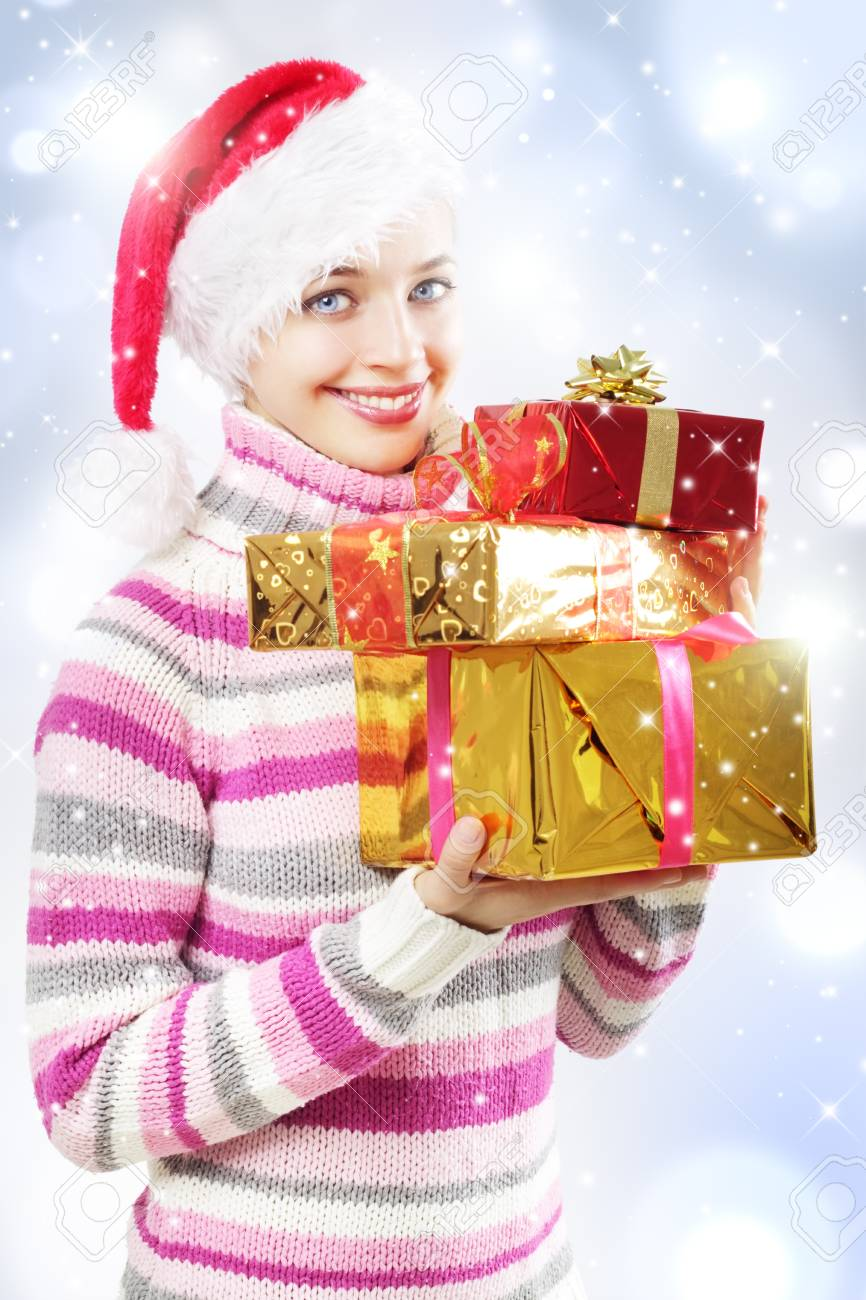 Santa girl with Christmas gifts on a light background Stock Photo - 10613571
