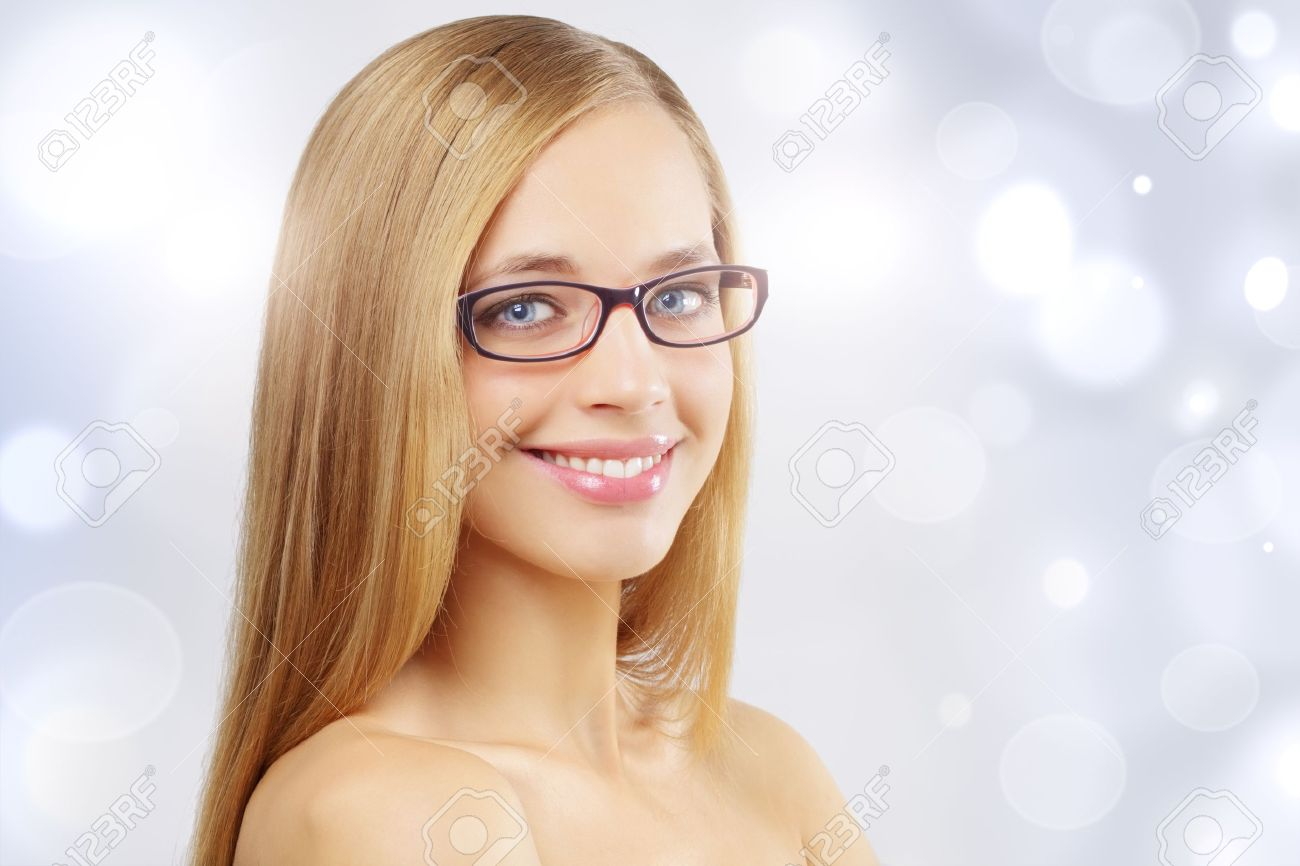 Girl wearing eyeglasses. Light blue background Stock Photo - 10798406