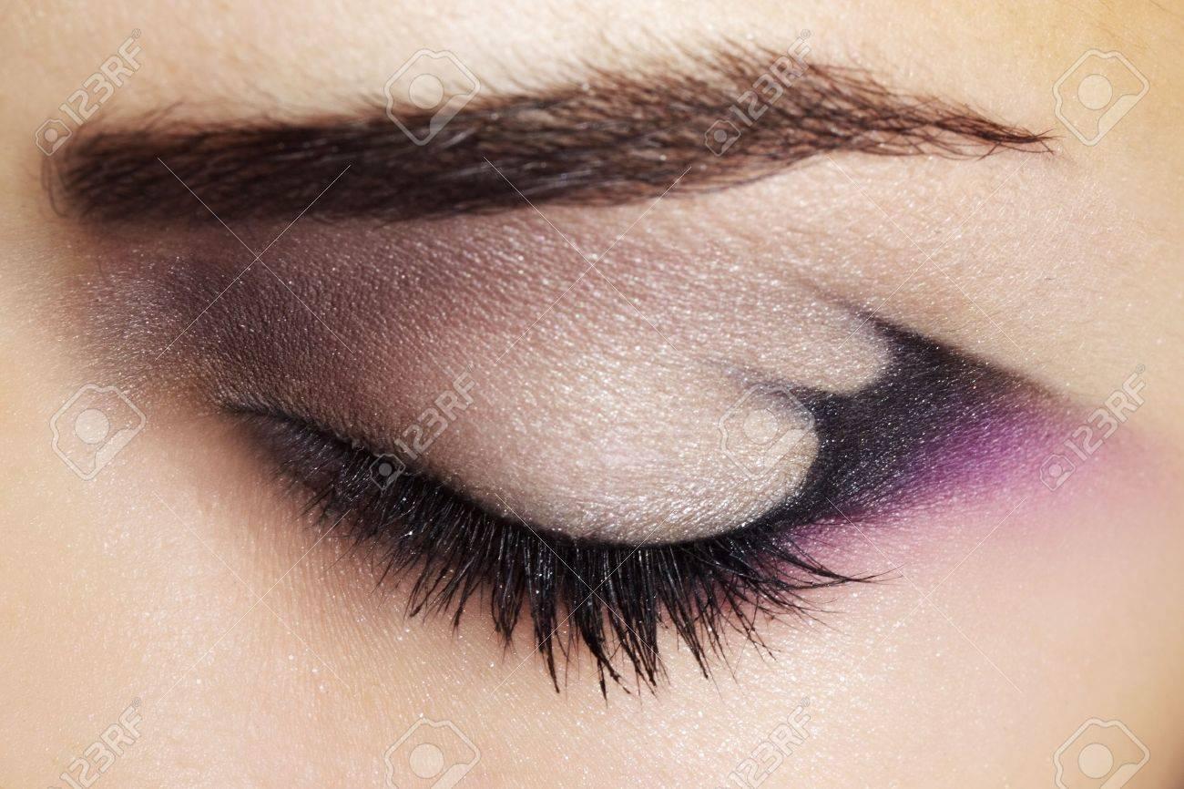 Purple Eye Makeup Beautiful eye makeup close up - 15442546