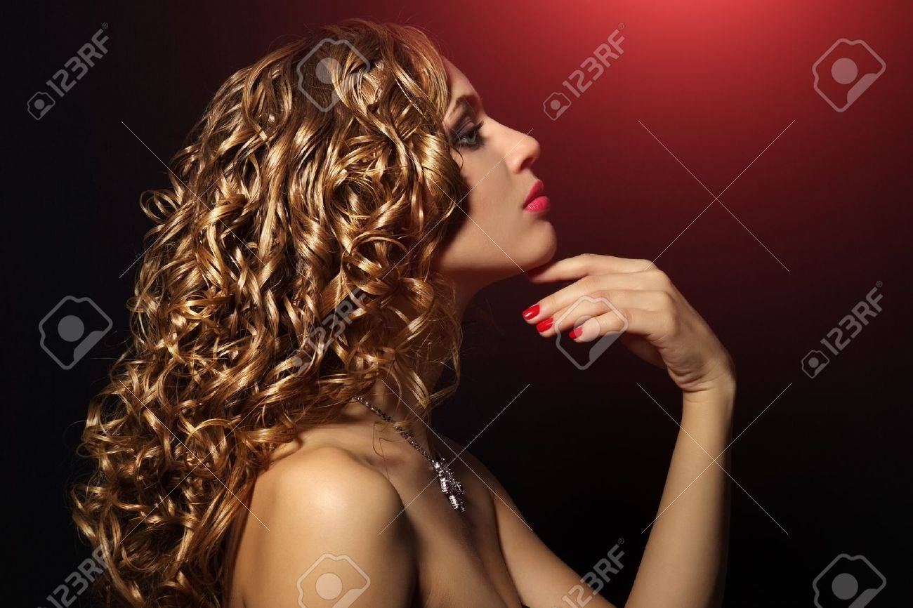 Portrait of a beautiful girl with curly hair on black background Stock Photo - 16025104
