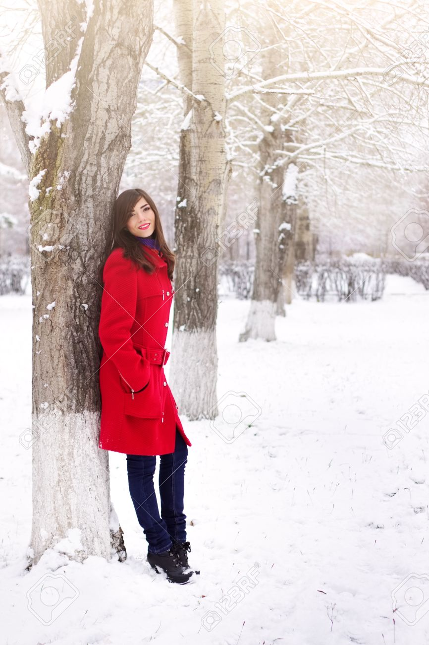 Beautiful Elegant Woman In Red Coat Winter Nature Stock Photo