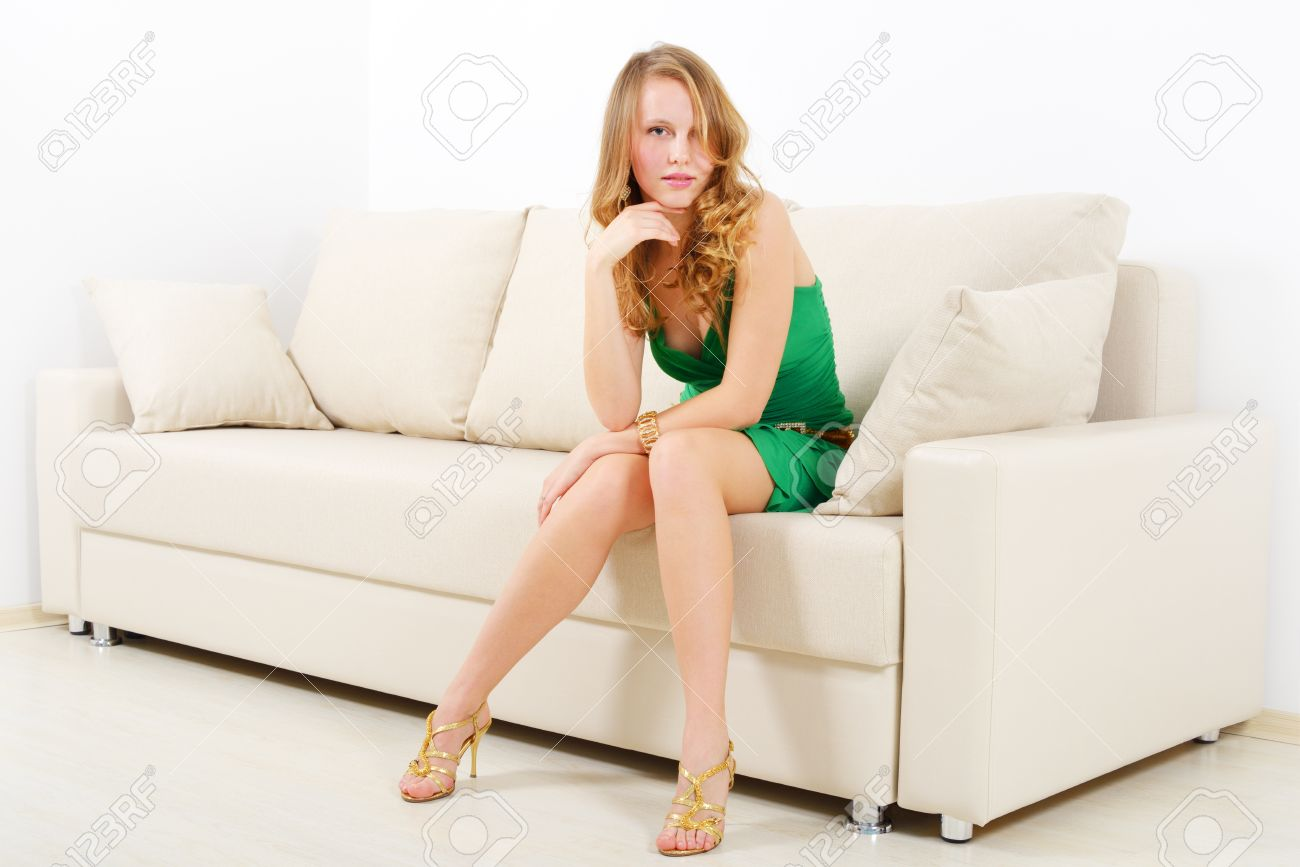 Elegant girl on sofa  light background Stock Photo - 16660365