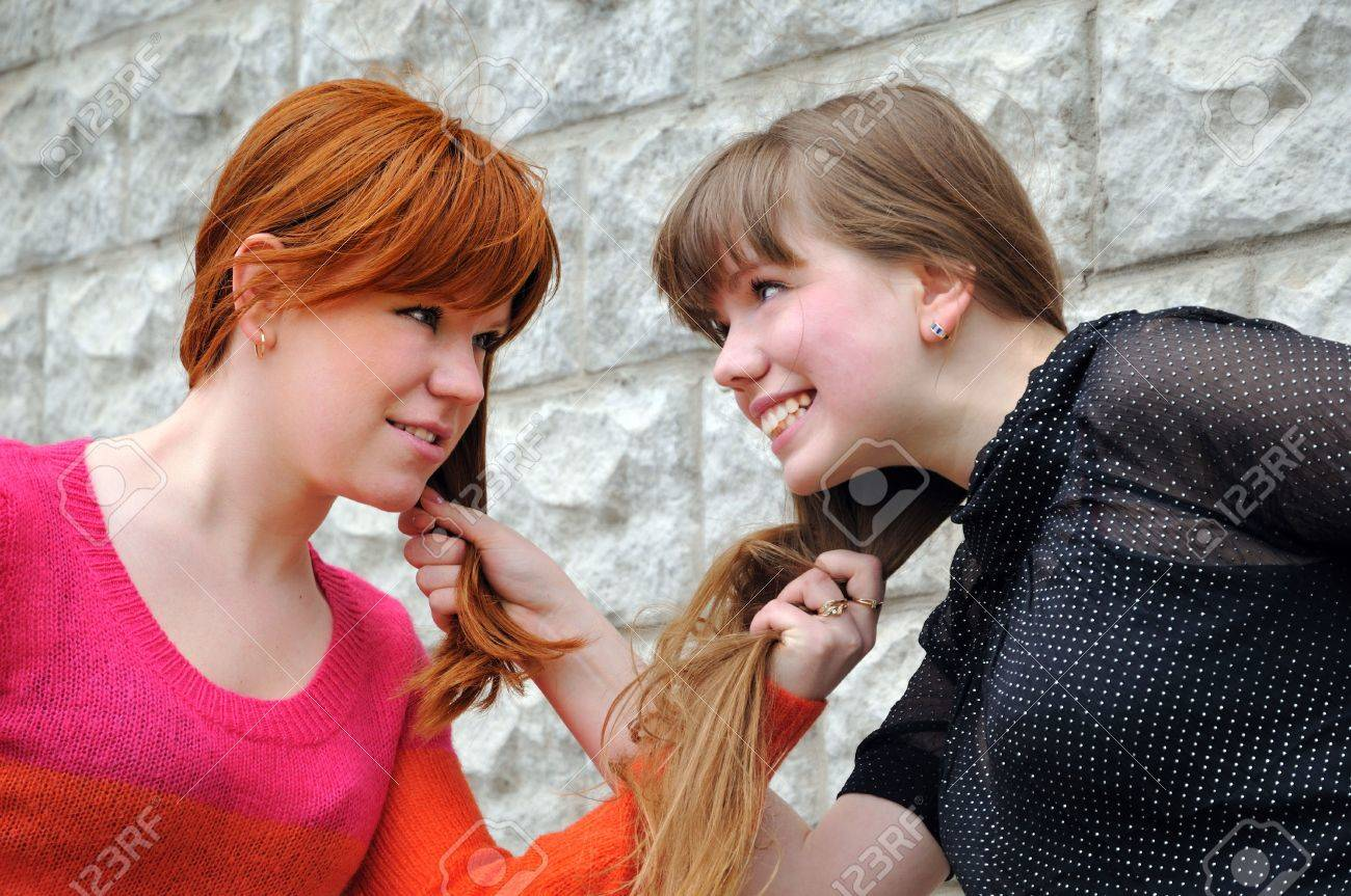 Two beautiful sisters pull each other's hair Stock Photo - 4863182