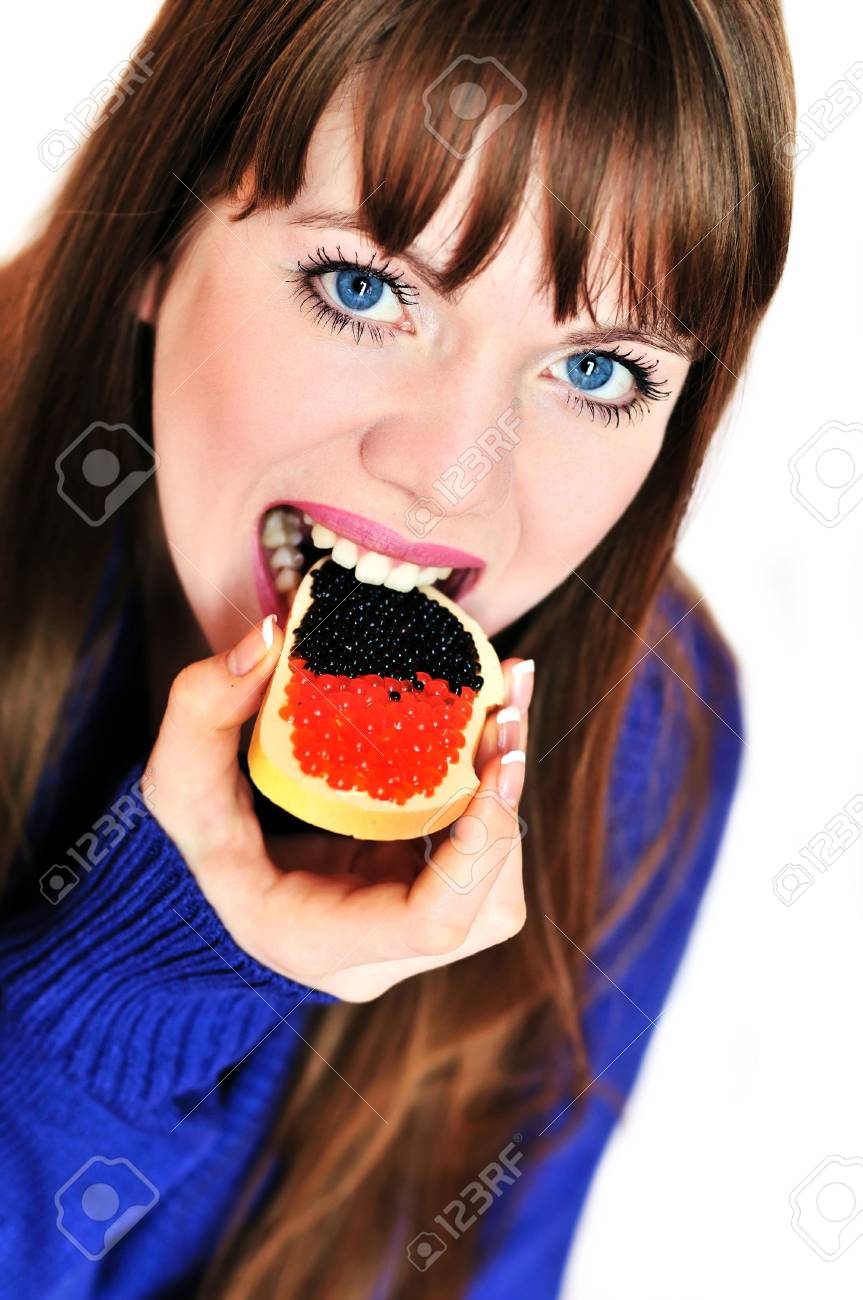 girl eating butterbrad with red and blach caviar Stock Photo - 6534967