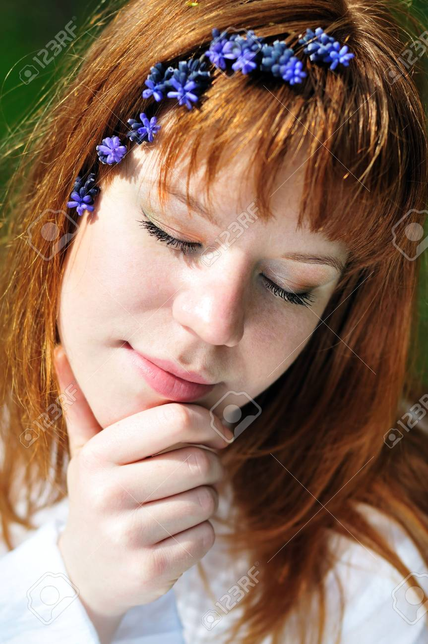 redheaded girl in the spring forest with flowers in her hair Stock Photo - 6808054