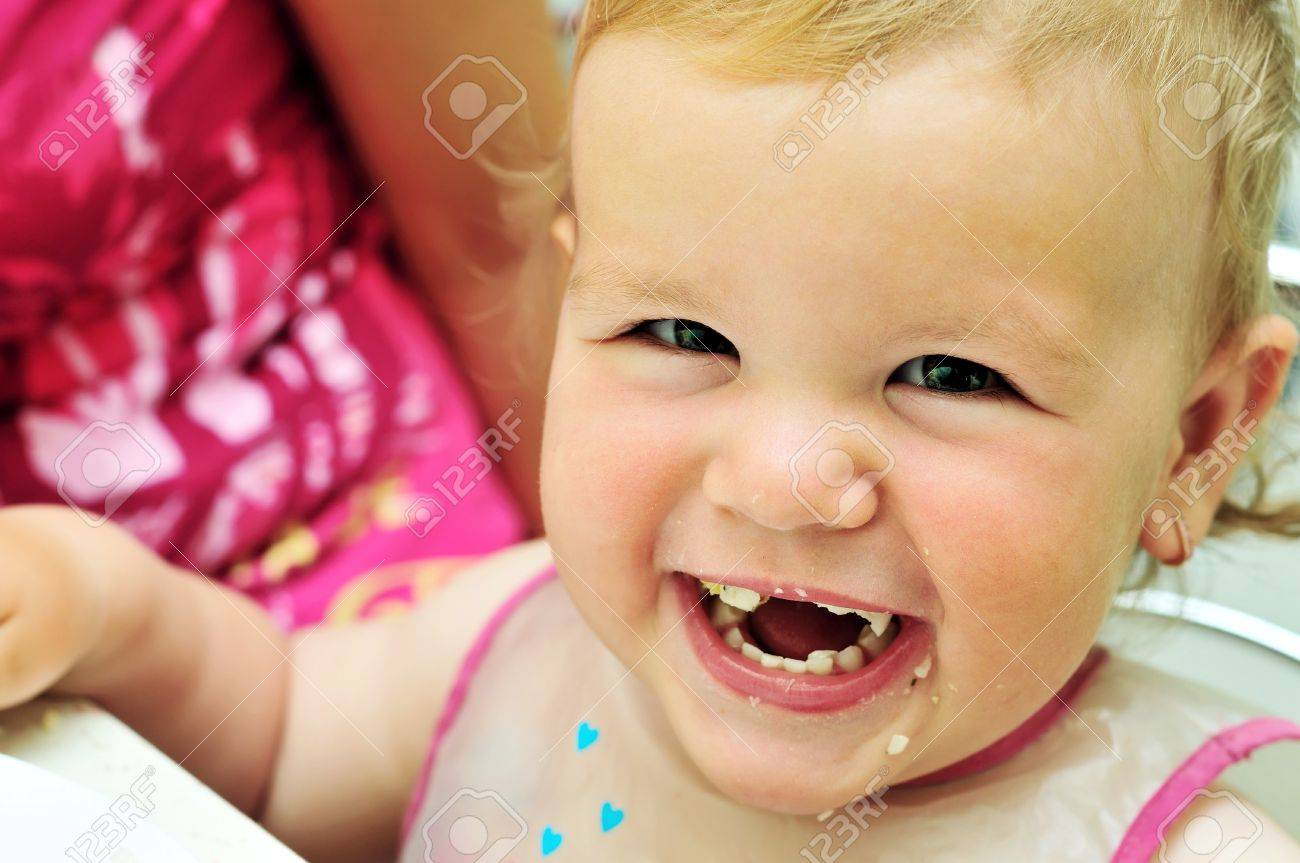 face of happy eating sweet baby girl stock photo, picture and