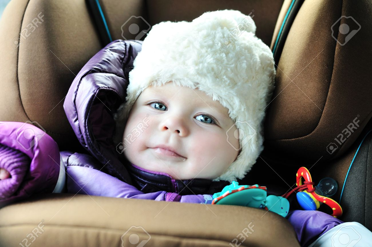 8 months old baby girl in a safety car seat