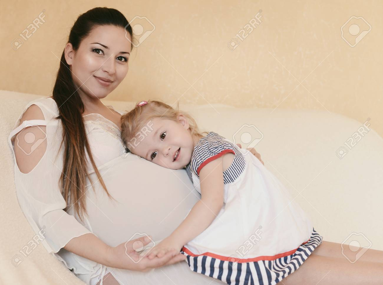 pregnant mother with loving daughter in soft selective focus Stock Photo - 18342148