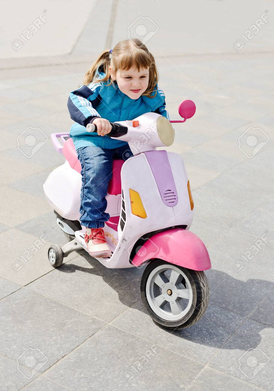 little girl ride a motorcycle Stock Photo - 27628495