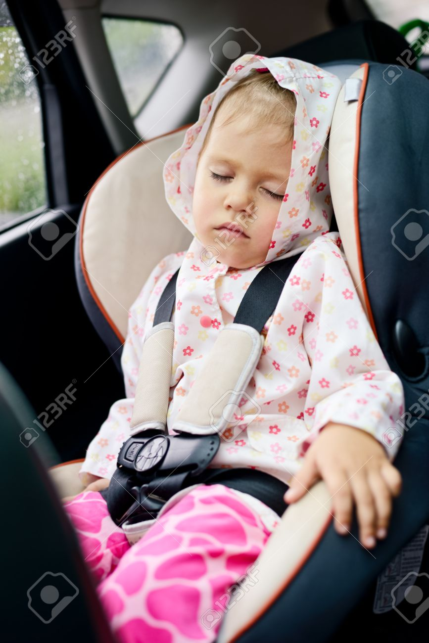Toddler Girl Sleeping In Car Seat Stock Photo Picture And Royalty