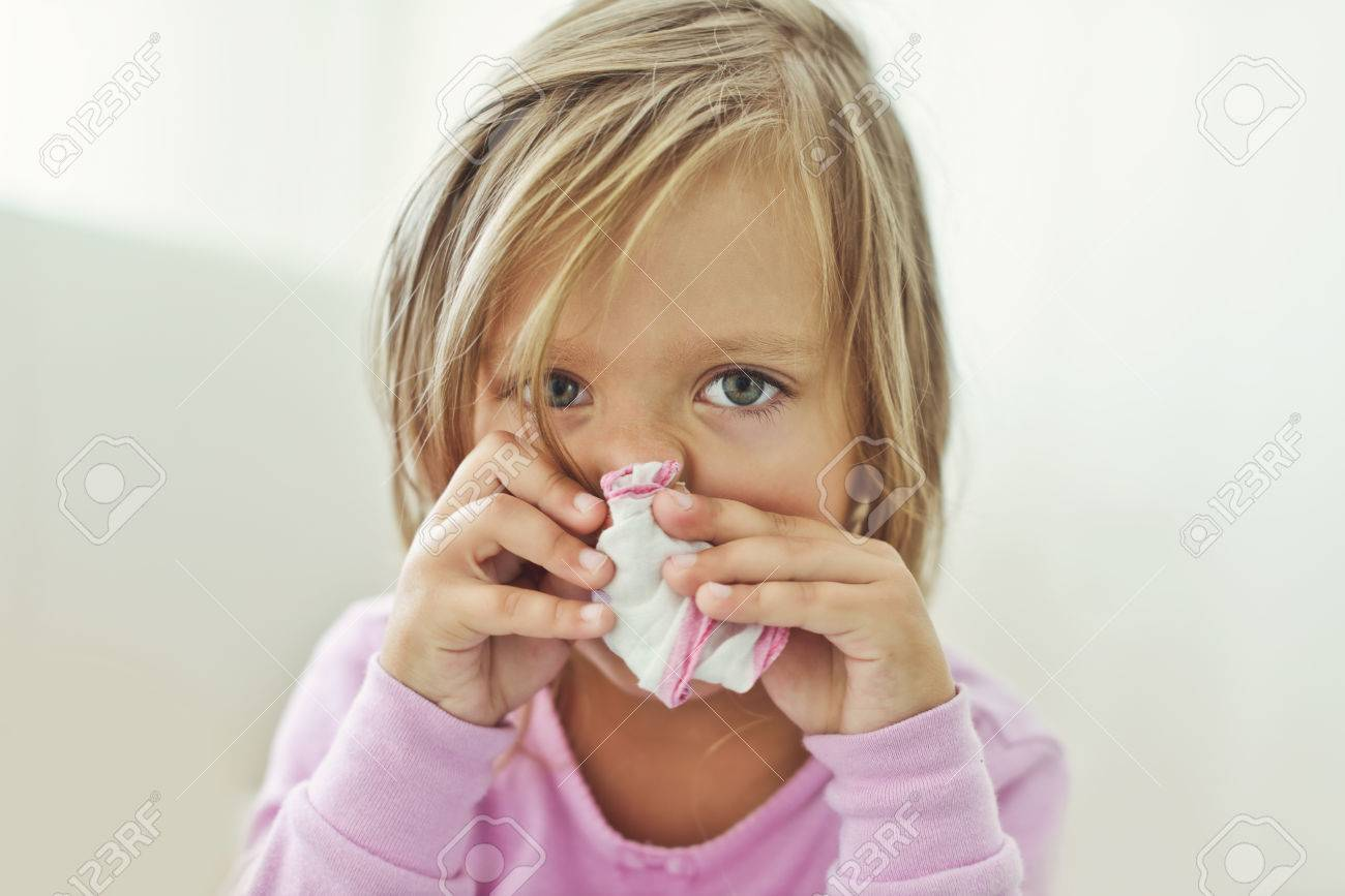 sick toddler girl with handkerchief at the home - 50529967