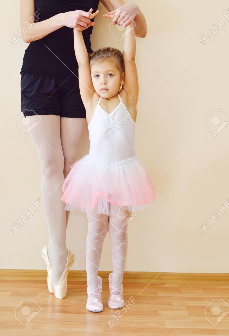 98820536cf29 Little Girl In The Ballet School With Her Teacher Stock Photo ...
