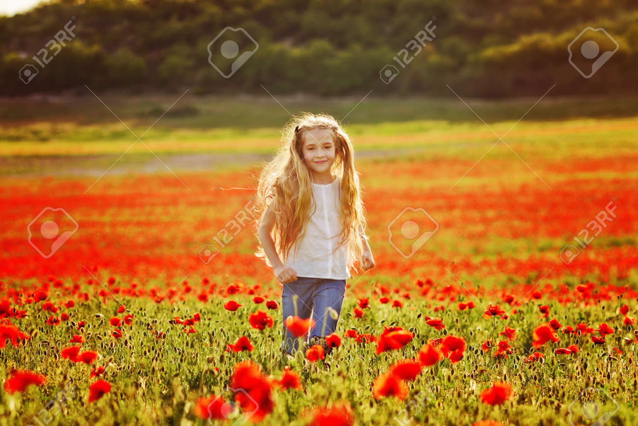 girl running in field of red poppies - 148617002