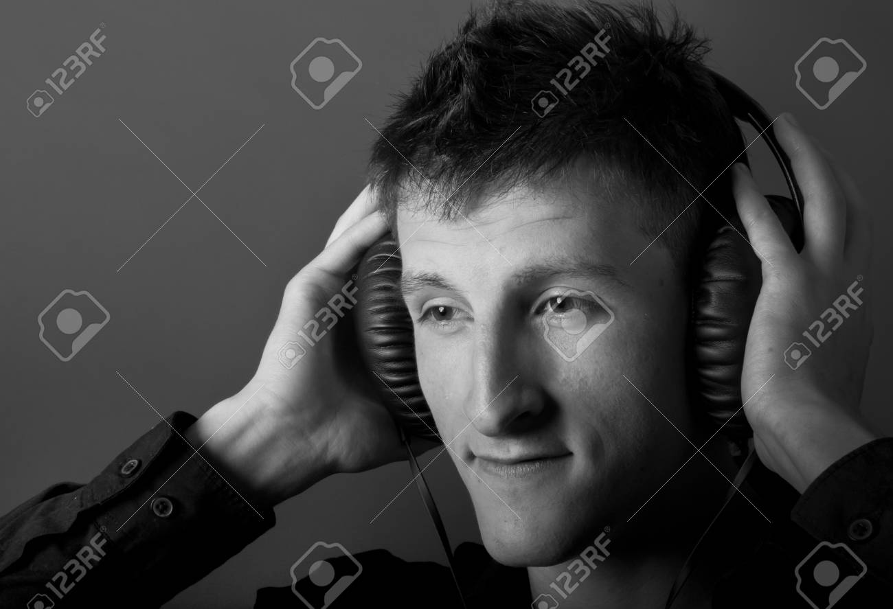 Young male person listening to music with headphones Stock Photo - 9881876