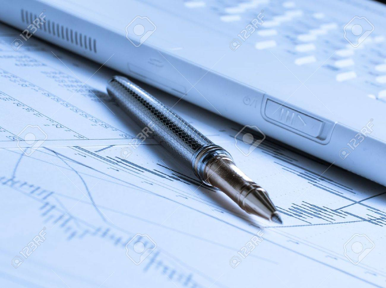 Accounting with pen and laptop on the table Stock Photo - 10796870