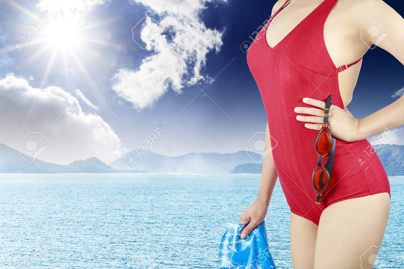 Young woman with red swimsuit and with a swimming cap  on  sea background Stock Photo - 14566991
